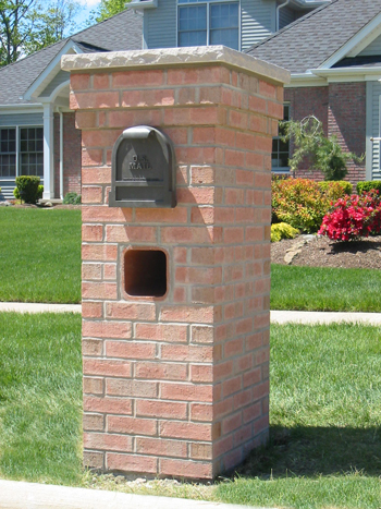 We can install a brick mailbox pillar that is impervious to snow plows